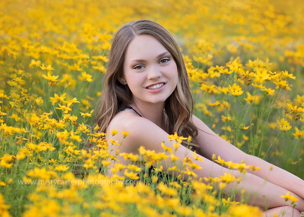 girl in thick yellow flowers