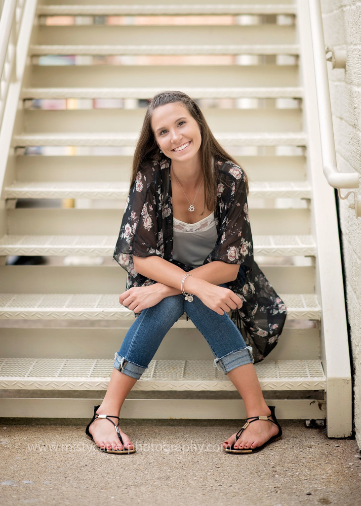 senior girl sitting on rusty steps