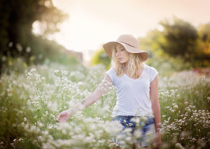 best of senior photographers cary, il girl in field of wild flowers