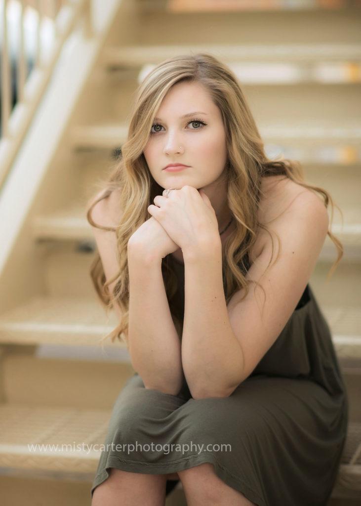 tousled hair and fair skin girl sitting on steps