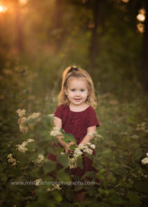 picture of smiling toddler in forest