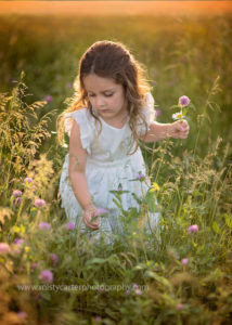 artful picture of girl picking wildflowers