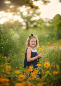 wall art portrait of young girl in sunflowers