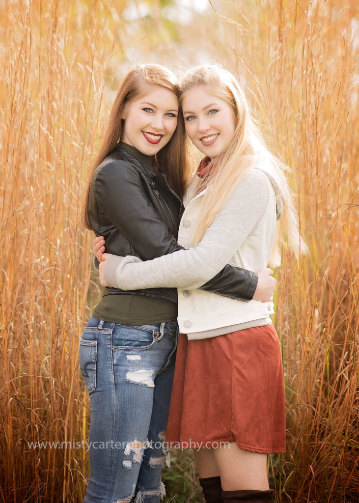 twin girls hugging for senior pictures