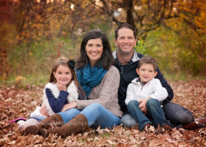 family in fall leaves