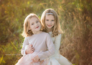 Sisters hugging in wall decor portrait