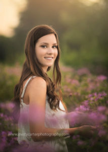 sunset glow over flowers and classically beautiful girl
