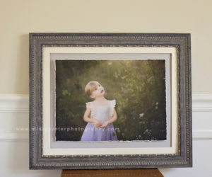 display family portrait in frame on wall