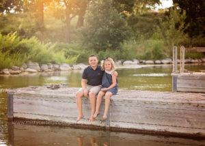 outdoor family picture in front of pond