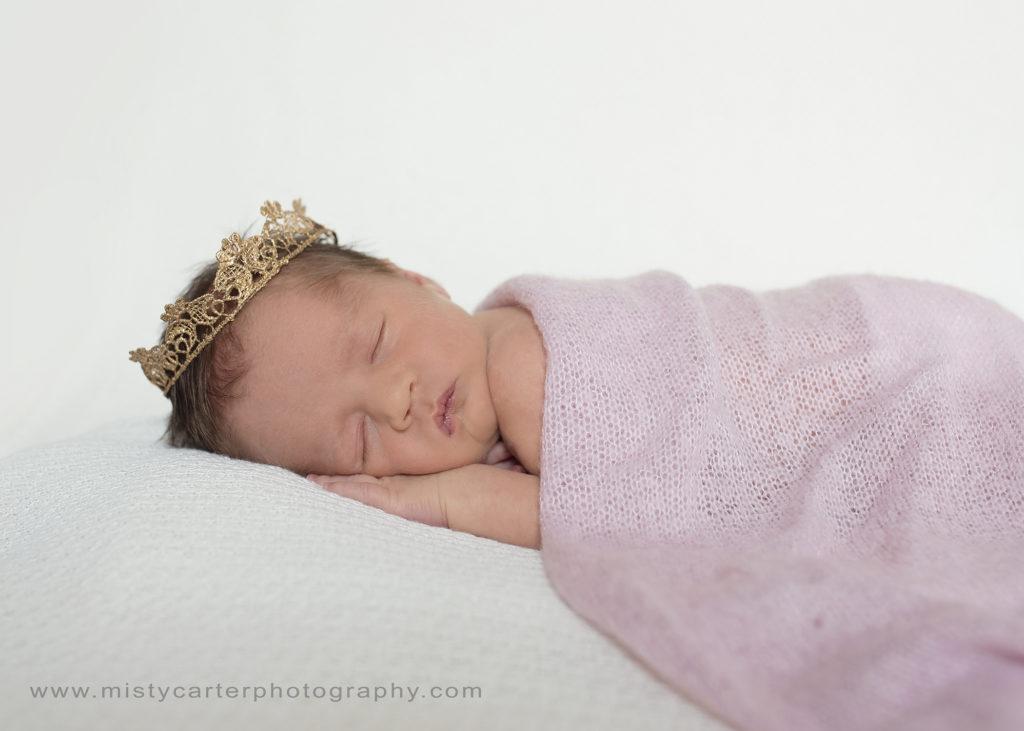 baby girl wearing crown